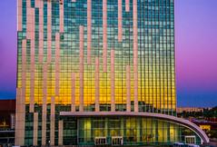 tramonto allo specchio (pierluigi.carrano) Tags: sunset rome roma reflection building skyscraper nikon tramonto grattacielo colori riflessi nikonflickraward iamnikon flickrtravelaward d3100