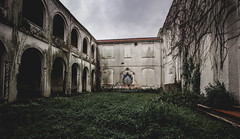 Solitary Confinement (fuzzy_dunlop_nola) Tags: old building abandoned grey louisiana arch outdoor decay empty samsung dreary wideangle arches orphanage vacant 12mm manor solitary desolate derelict uninhabited lorn ruraldecay isolated deteriorated ramshackle tattered hopehaven unoccupied southlouisiana madonnamanor rokinon samsungnx nx500 samyang12mm samsungnx500 samyangcsc12mmf20ncscs
