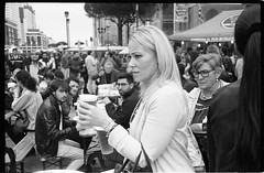 (Two Beer Or Not Two Beer) (Robbie McIntosh) Tags: leica blackandwhite bw woman film beer monochrome analog 35mm beers candid strangers streetphotography rangefinder bn summicron negative blonde analogue streetfood m2 ilford fp4 biancoenero argentique leicam2 fingerfood dyi selfdeveloped ilfordfp4 pellicola analogico sunny16 nometering leicam filmisnotdead autaut leicasummicron35mmf20iv guessexposure summicron35mmf20iv leicasummicron35mmf2i internationalstreetfoodfestival arsimagofd arsimagofddeveloper