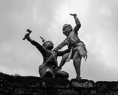 Hanuman and ogre (tmeallen) Tags: cambodia knife demon hanuman fighting ax silhouetted ogre angkorthom khmerclassicaldance asura terraceoftheelephants