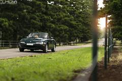 BRG NA8C (Joseph Hui (J_HUI)) Tags: tree grass car canon bokeh f14 85mm sigma convertible mazda miata sportscar mx5 6d softtop eunos britishracinggreen jhui na8c