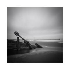 Defeated (Lindi m) Tags: longexposure sea sand nikon northumberland northsea marker coastline blythe breakwater squarecropped overpowered