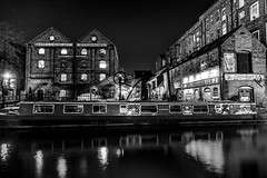 Between Brick and Water is a Boat (darren.cowley) Tags: nottingham blackandwhite reflection water architecture stars lights canal illuminated narrowboat brickwork