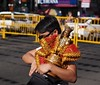 """Let me see if I can fit this in here"" (beanhead4529) Tags: bokeh philippines streetphotography cebu cebucity sinulog stonino santonino philippineislands microfourthirds olympus45mm olympusem5"