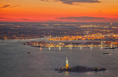 Lady Liberty Sunset (michaelelliottnyc) Tags: nyc newyorkcity sunset sky orange sun newyork water statue river observation island lights freedom harbor worldtradecenter landmark deck historical wtc statueofliberty immigration ladyliberty oneworldtrade