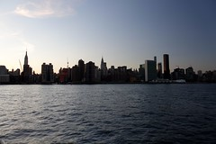 NYC skyline from the water's edge (nicknormal) Tags: construction crane unitednations eastriver empirestatebuilding chryslerbuilding
