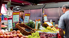 Grapes are good! (Derek Midgley) Tags: people men market candid australia melbourne victoria trade dsc01519