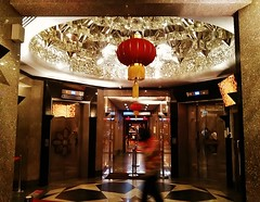 the chamber of the crystal dome (SM Tham) Tags: building glass reflections lights crystal geometry chinese malaysia dome lanterns kualalumpur elevators kltower lifts corridors passageways menarakualalumpur kualalumpurtower liftlobby