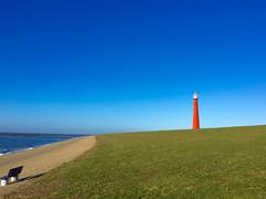 Leuchtturm Huisduinen, genannt Lange Jaap (latariosreise) Tags: blue sky haven holland netherlands europa europe day outdoor tag himmel wolken architektur blau cheerful landschaft leuchtturm niederlande kste denhelder deich huisduinen langejaap heiter nordholland appleiphone6 latarios