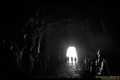Towards the daylight. (jongoikoh) Tags: girls white black rock darkness 4 tunnel natura tunel society cavern foz rocas piedras silouettes navarra cueva euskal herria nafarroa haitzak magnificas lumbier