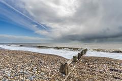 Where once, there were blue skies... (D1g1tal Eye) Tags: sea sky cloud storm beach rain coast nikon sigma wave 1020mm groyne ndgrad gradnd d7000