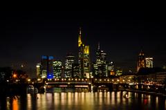 Frankfurt by night (hjuengst) Tags: longexposure bridge reflection skyline night skyscraper river germany nightshot nacht frankfurt main spiegelung nachtaufnahme langzeitbelichtung mainhattan reflektionen altebrcke ignazbubisbrcke