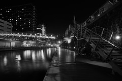 Night Lines (McQuaide Photography) Tags: city longexposure nightphotography bridge light shadow urban blackandwhite bw holland reflection building water netherlands monochrome dutch lines amsterdam architecture modern night stairs zeiss outside mono licht blackwhite lowlight europe waterfront nacht outdoor availablelight sony tripod steps nederland wideangle brug fullframe alpha 16mm modernarchitecture stad manfrotto noordholland gebouw c1 wideanglelens 1635mm northholland a7ii groothoek phaseone variotessar captureone mirrorless sonyzeiss mcquaidephotography ilce7m2 captureonepro9