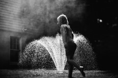 The beauty of the world... (privizzinis passion photography) Tags: light summer people blackandwhite water girl monochrome childhood kids children fun outdoors child play outdoor joy grain sprinkler freelensed