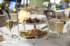 Our tier for afternoon tea and our glasses of Pommery Champagne (thewanderingeater) Tags: nyc manhattan champagne afternoontea uppereastside thelowell thepembrokeroom