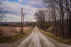 Dirt Road (Evan's Life Through The Lens) Tags: life camera blue orange lake color college water glass beautiful vintage lens drive cool warm vermont day looking minolta bright cloudy farm vibrant f14 sony adventure land 58mm a7s