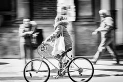 Passing By (Dan Dewan) Tags: portrait bw  woman motion girl bike bicycle canon blackwhite cyclist ottawa sunday april panning bankstreet 2016 centretown somersetstreet photographist canonef70200mm14lisusm canon7dmarkii dandewan