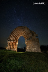 Puerta a las estrellas (Iván F.) Tags: old travel light tourism beautiful miguel architecture night canon de landscape lite eos star spain ancient san arch nightscape ngc mini torch estrellas nocturna 29 burgos arco mag 6d abbandoned 14mm samyang anciente sasamon mazarreros