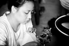Fix it better than a man (Litratistica Images NYC) Tags: camera blackandwhite reflection girl fix philippines working streetphotography indoor littlegirl fixing streetphotographer ilocossur tagudin canon70200 canoneos5d earldolphy litratisticaimages cherrydolphy
