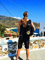 All He Surveys (lost.mohican) Tags: blue sea summer sky sun man black beach cup water lines stone wall swim hair bottle long tank power terrace top aegean straw pot greece clay blond backpack tall ponytail trunks hillside streaked whitewashed lean