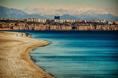 The forgotten mountains (Melissa Maples) Tags: blue winter sea snow mountains beach water skyline turkey nikon asia mediterranean trkiye cliffs antalya nikkor vr afs  18200mm  f3556g  18200mmf3556g d5100 konyaaltbeach