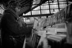 Even the youngsters like Frank (Just Ard) Tags: street people blackandwhite bw white black blancoynegro girl monochrome face lens person photography mono noiretblanc market zwartwit candid stall olympus lp record unposed  biancoenero omd mft em5 17mmprime schwarzundweis