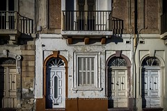 Nice doors... (Syahrel Azha Hashim) Tags: street travel light vacation holiday detail building architecture 35mm prime colorful doors exterior dof getaway sony entrance streetphotography naturallight malta handheld shallow simple a7ii prettybay sonya7 syahrel ilce7m2