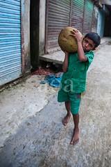 5D8_7210 (bandashing) Tags: england fruit manchester child heavy spikes sylhet bangladesh carry jackfruit socialdocumentary childlabour aoa bandashing noyabazar akhtarowaisahmed boroshala
