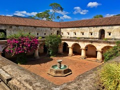 Capuchinas Convent in Antigua Guatemala ((Jessica)) Tags: old tree church fountain stone architecture ancient ruins vibrant guatemala colonial perspective sunny arches bluesky courtyard nuns antigua spanish pillars convent crumbling pw bougainvillia capuchinas capuchins