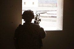 A U.S. Army Soldier assigned to 4th Battalion, 23rd Infantry Regiment, 2nd Brigade Combat Team, 2nd Infantry Division, provides security at a window during Decisive Action Rotation 16-03 at Fort Irwin, Calif., Jan. 28, 2016. (U.S. Army Photo by Spc. Austi (Operations Group, National Training Center) Tags: california usa ntc fortirwin 2ndinfantrydivision 23rdinfantryregiment 2ndbrigadecombatteam 4thbattalion majovedesert spcaustinmriel
