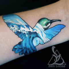 Hummingbird-shape-with-tidal-wave-in-the-negative-space-tattoo-on-wrist-by-ben-lucas-at-eye-of-jade-tattoo-in-chico-californina