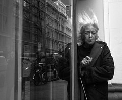(elkogan) Tags: street nyc newyorkcity reflection hair mono wind cigarette streetphotography figure