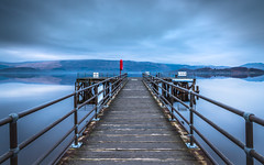 Luss (rgcxyz35) Tags: blue scotland lifebelt pier water lochlomond reflection lochs luss