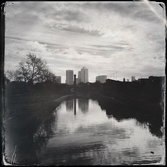 Regents Canal (firstnameunknown) Tags: london water monochrome skyline reflections canal blackwhite cityscape regentscanal canarywharf eastlondon iphoneography hipstamatic