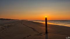 Footprints on the beach (BraCom (Bram)) Tags: sunset shadow sea sun lighthouse holland beach netherlands strand canon zonsondergang surf waves widescreen dunes nederland noordzee zee pole northsea nl 169 schaduw duinen zon branding ouddorp zuidholland goereeoverflakkee paal golven strandpaal southholland canonef24105mm beachpole bracom vurtoren canoneos5dmkiii bramvanbroekhoven