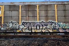 MOE (TheGraffitiHunters) Tags: auto street blue moon white black art car yellow train graffiti colorful paint ship space gray tracks spray robots moe freight racks carriers autoracks benched benching
