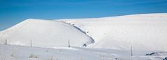 Snow Covered Hillside (wyojones) Tags: winter sun snow storm clouds wyoming np hillside winterstorm lander redcanyon blueshy southpass wyojones southpasshighway wyoming28