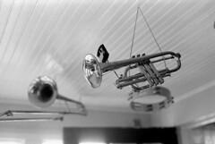 Flying Brass (bergytone) Tags: bw music film analog nikon stock instrument hp5 trombone horn em brass ilford xtol cornet 8min