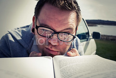 Hard Reading (the UMF) Tags: boy portrait people man male eye face horizontal closeup notebook person reading glasses book crossprocessed holding education hand looking serious young highcontrast retro read photograph blank page stare concept copyspace staring stress midday cracked 20s gurning caucasian squinting oneman youthculture realpeople humanhead singleobject ruralscene