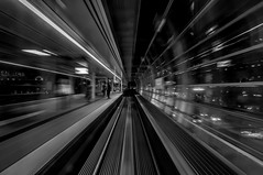 Approaching the station (rdpe50) Tags: bw station night platform motionblur rails handheld passenger skytrain vancouverbc converginglines