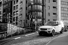 The Range Rover and  the Mohican (John fae Fife) Tags: street luxembourg xe2 fujifilmx