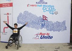 Ramesh celebrates his victory after coming sixth in the 3km race (Handicap International UK) Tags: nepal earthquake kathmandu survivors disability