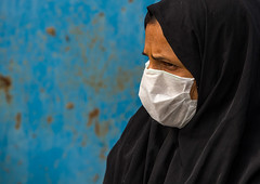 a woman wearing a face mask to protect from h1n1 influenza in panjshambe bazar, Hormozgan, Minab, Iran (Eric Lafforgue) Tags: street people urban woman horizontal outdoors photography persian women asia day iran muslim islam citylife persia streetscene headshot womenonly health pollution environment iranian bazaar protection environmentalism influenza adultsonly oneperson islamic protect burqa middleeastern facemask sunni precaution chador balouch h1n1 hormozgan onewomanonly middleagedwoman   1people  iro thursdaymarket  minab colourpicture  panjshambe panjshambebazar iran034i2965 boregheh