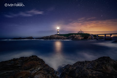 Estrellas en Isla Pancha (Iván F.) Tags: longexposure travel sea sky lighthouse seascape tourism water marina canon stars landscape star coast mar spain rocks long exposure ngc asturias paisaje full frame 28 lugo pancha ribadeo cantabrico 14mm samyang islla canonistas