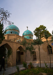 three domes moshtaghie, Central County, Kerman, Iran (Eric Lafforgue) Tags: old blue trees decorations building history vertical architecture garden religious outdoors persian ancient asia iran muslim islam religion persia nobody courtyard mosque architectural historic holy tiles historical iranian sight ornate kerman decorated qajar cupolas  placeofinterest   iro safavie  builtstructure centralcounty colourpicture  irandsc07260 moshtaghie