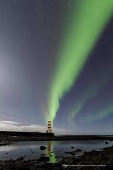 A touch of reflection (Kjartan Guðmundur) Tags: ocean nightphotography sea sky lighthouse seascape canon stars landscape iceland rocks nightscape ngc arctic shore nocturne ísland garður northernlights auroraborealis nordlys norðurljós photoguide canoneos5dmarkiii tokinaatx1628mmf28profx kjartanguðmundur