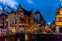 Blue hour in Alkmaar (zilverbat.) Tags: world nightphotography travel bridge blue winter heritage tourism netherlands dutch cheese architecture night buildings photography town europe nightlights nightshot image postcard centre nederland thenetherlands visit historic timelife bookcover bluehour innercity brug waag wintertime centrum hotspot afterdark global monumental brucke kaas toerisme avondfotografie dutchholland blauweuurtje zilverbat photographybynight canonpancakeef40mmf28stm elvinhagekpnplanetnl