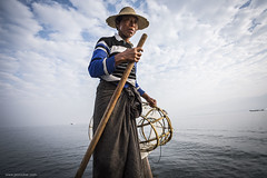 fisherman on Inle (jrockar) Tags: portrait people lake man net photography boat fisherman seasia shot burma documentary environmental snap instant myanmar inle moment decisive profession ordinarymadness oncearoundthesun idlelake