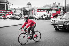 20160301_F0001: Red London transport (wfxue) Tags: road street red people blackandwhite bw london cars bike cycling cyclist traffic candid trafalgarsquare busses selectivecolor selectivecolour selectivecolouring selectivecoloring
