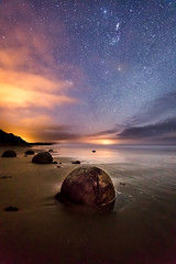 extraterrestrial dream (Franziska Liehl) Tags: ocean sea newzealand sky beach nature water beautiful rock night clouds stars wonder landscape sand solitude peace alien dream peaceful boulder special boulders fairy round mystical magical tale extraterrestrial moeraki shperical